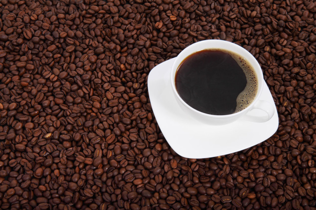 Coffee beans and fresh cup of coffee